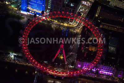 Aerial view of London, Jubilee Gardens and County Hall at night.