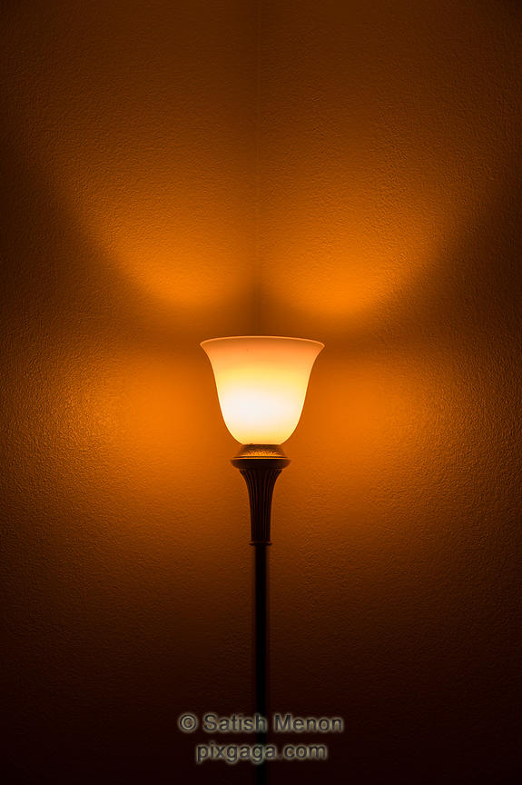 Lamp and lighting pattern on wall