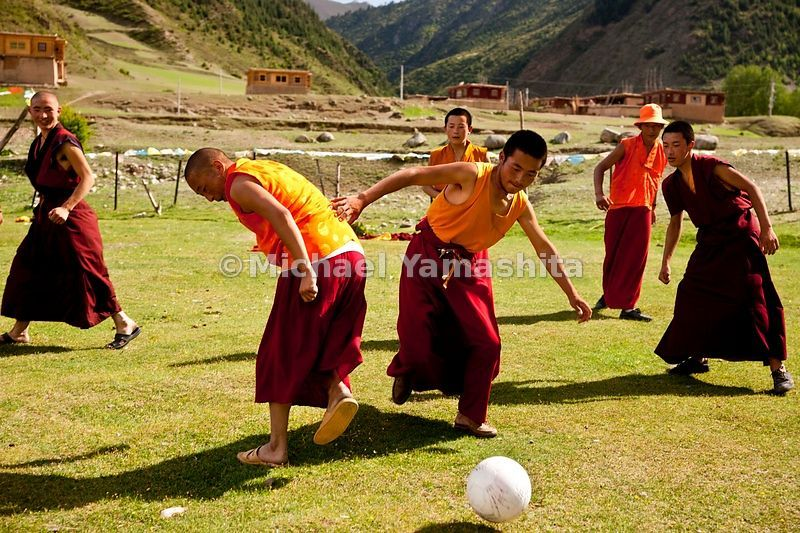 Dzongsar Monastery monks at play. Dzongsar located 120km south of Dege. Today is the last day of 3 day holiday and all come out to picnic on the grasslands below the monastery.....................................