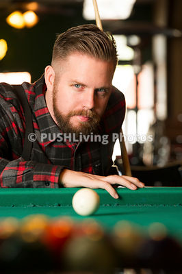 Man in a wheelchair playing pool
