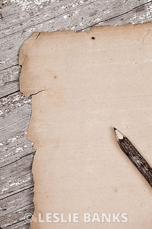 Vintage blank paper on rustic table