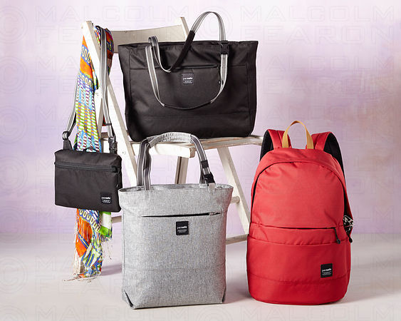 assorted multi colored travel bags