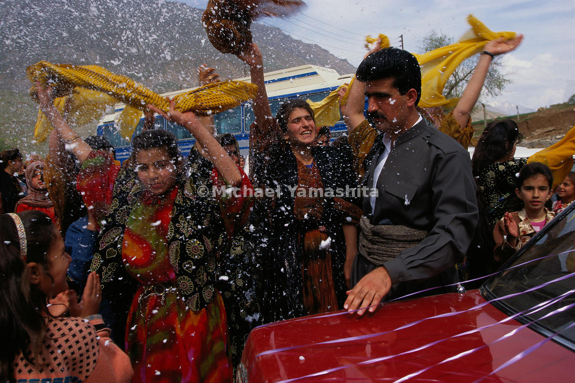 The Kurdish tribespeople that Marco Polo encountered during his travels were known as a warrior tribe. Merchants feared them, as they were reputed to plunder caravans filled with goods for trade.  Today, Kurds are still considered fierce fighters, rarely seen without a weapon at the ready, even at festive events likes weddings. Here, guests spray shaving foam instead of rice on the bridegroom.