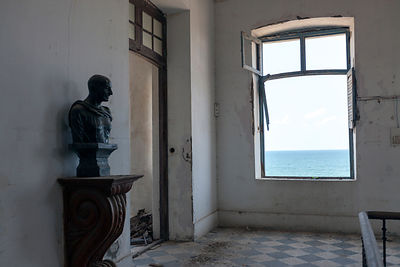 India - Pondicherry - A statue of Gandhi in the derelict Hotel du Ville that has been saved by INTACH (Indian National Trust for Art and Cultural Heritage)