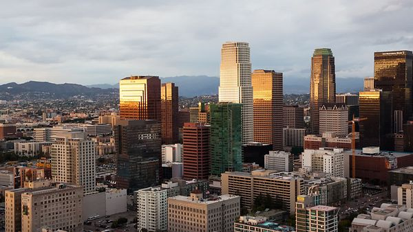 Bird's Eye: Panning L.A. Skyline Under A Dramatic Cloud Deck & Metallic Sunset (Day To Night)