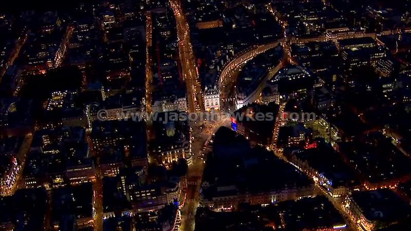Aerial footage of Piccadilly Circus at night, London, England, UK