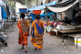 Women vendors walking towards Sassoon dock, one of the largest fish markets in Mumbai, India