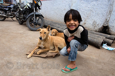 Girl and Pariah street dogs in Pushkar, Rajasthan, India