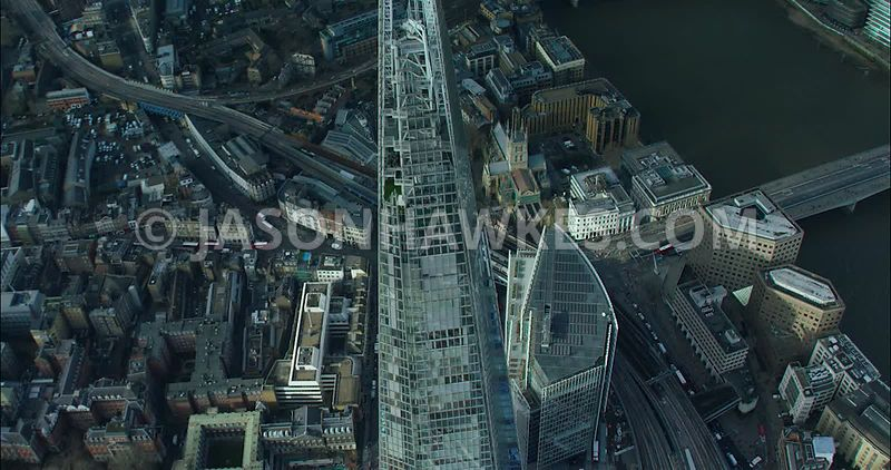 London Aerial footage, The Shard towards City of London skyline.