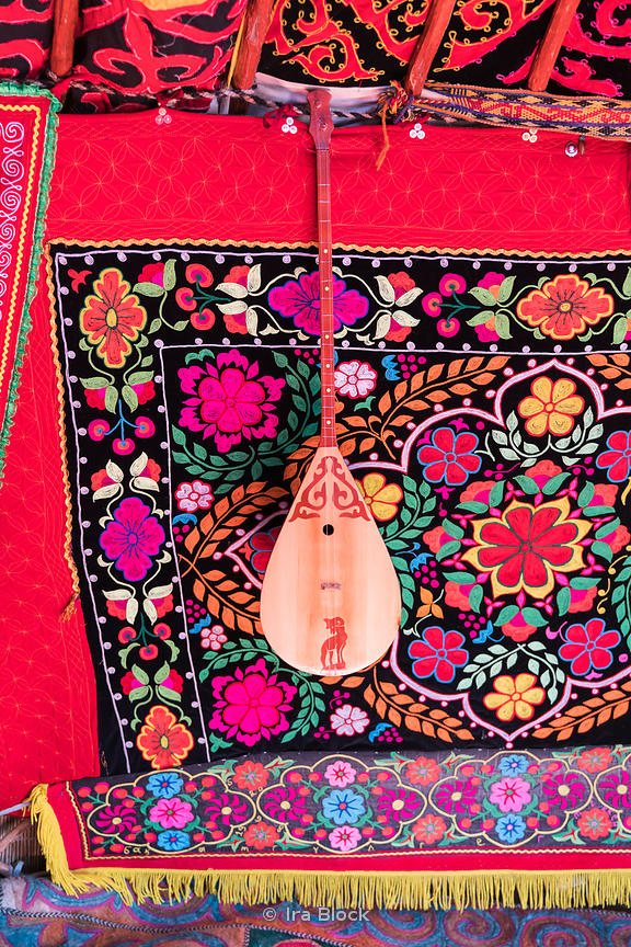 A dombra, a traditional Kazakh musical instrument hanging in a ger or yurt in Ölgii, the capital of the Bayan-Ölgii Aimag of Mongolia, located in the far west of Mongolia.