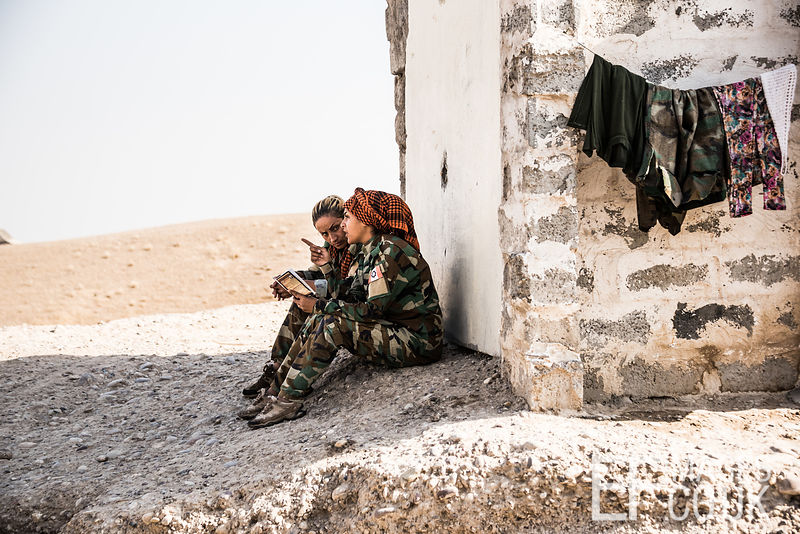 PAK (Kurdistan Freedom Party) female fighters, taking some time out to read, at their base north of Hawija, where Kurdish Iranian fighters are holding the line against the last vestiges of Daesh and preparing to engage the Hashd al Shaabi forces threatening Kirkuk. Kirkuk Governorate, Iraq, 14th October 2017
