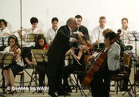 Argentine-Israeli Daniel Barenboim conducts the Jewish and Arab musicians of the West-Eastern Divan Orchestra in Ramallah
