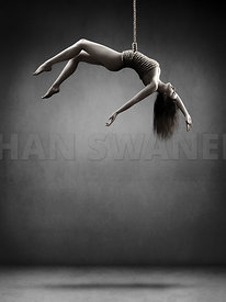 Woman hanging on a rope