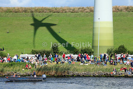 Viewers under wind turbine, Sail Amsterdam 2010, Noordzeekanaal, Netherlands
