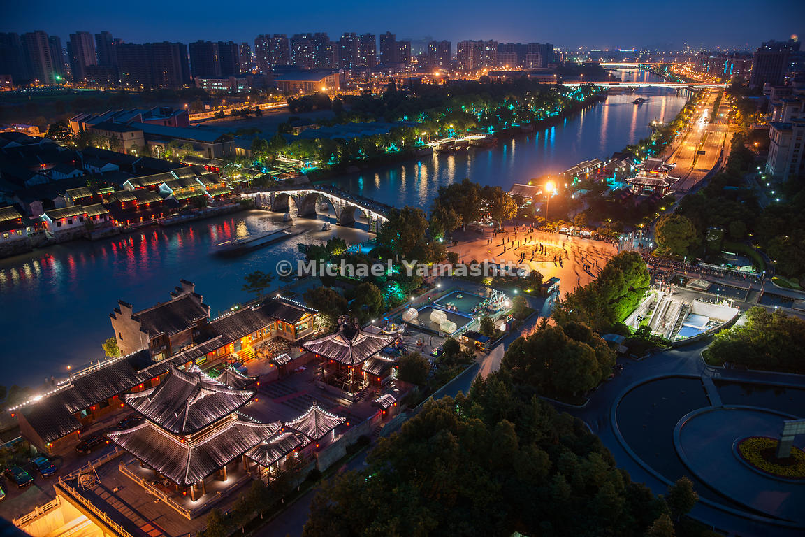 Barges long piled the 1,100-mile canal between Beijing and Hangzhou, its glittering southern terminus. Bankside revitalization includes replicas of ancient temples.