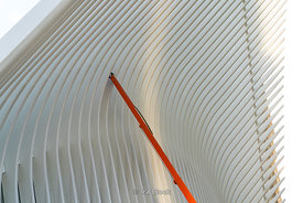 An orange crane working in the Oculus in Lower Manhattan in New York City.