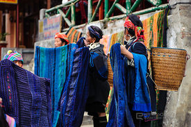 Hmong Women Showing Embroidered Cloth and Wears to Tourists