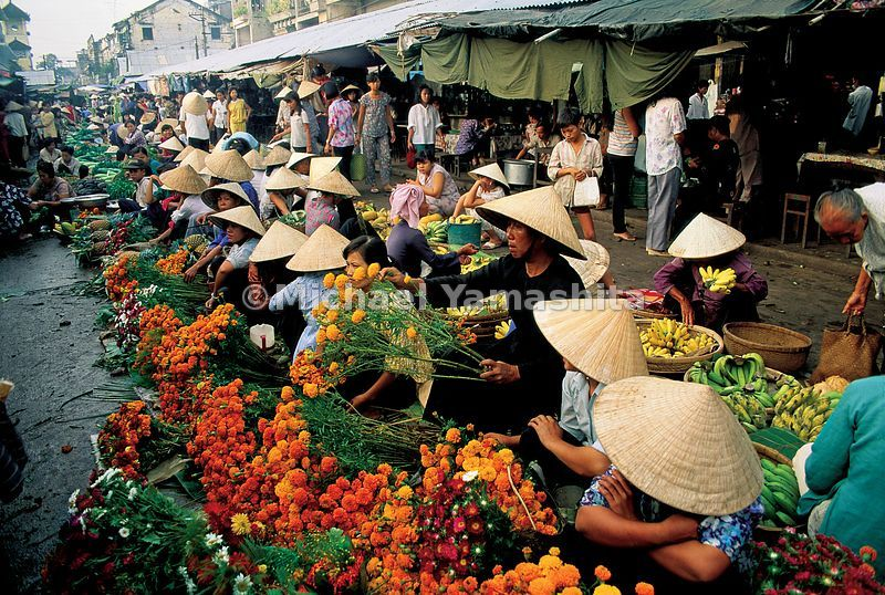 Flower growers and sellers do a brisk business for the Tet New Year in Cantho Market.