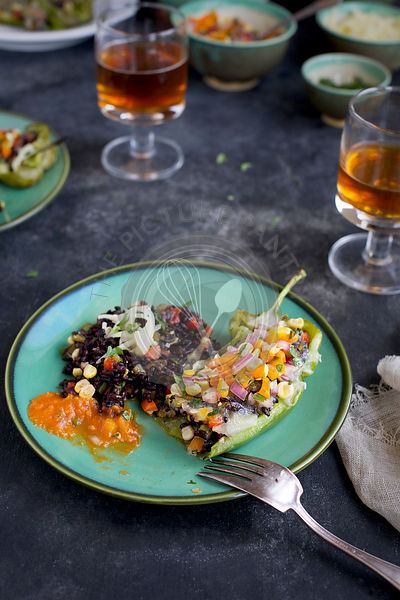 Black Rice Stuff Roasted Peppers with Veggie Pico de Gallo served with salsa and beer.