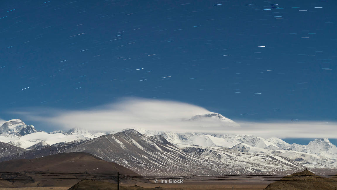 Cho Oyu Mountain in Tibet photographed at night by moonlight, with star trails. Shot from the north in the town of Tingri.
