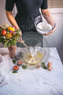 Woman preparing a cake mixture