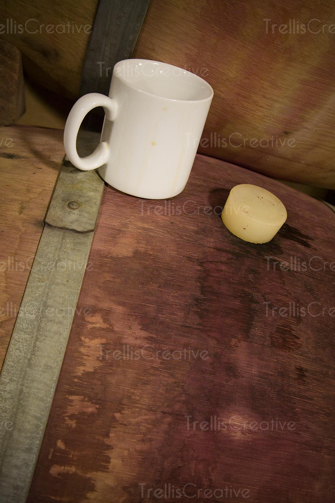 A coffee mug on top of a wine barrel