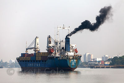 The ship Oel Victory (from Mumbai) belches  black smoke on the Hooghly River near Metiabruz, Kolkata, India.