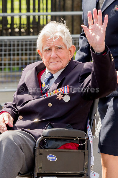 Old Soldier waves in the Veteran's Parade in London