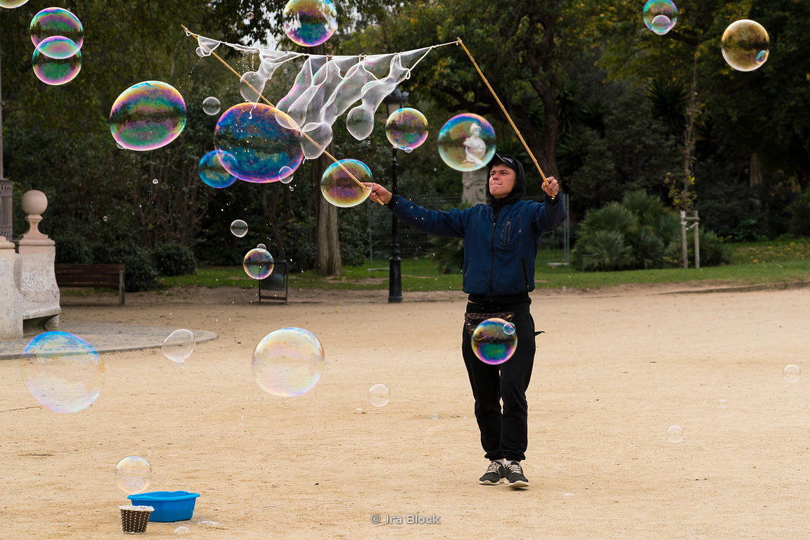 A man creates big soap bubbles at Parc de la Ciutadella in Barcelona, Spain.