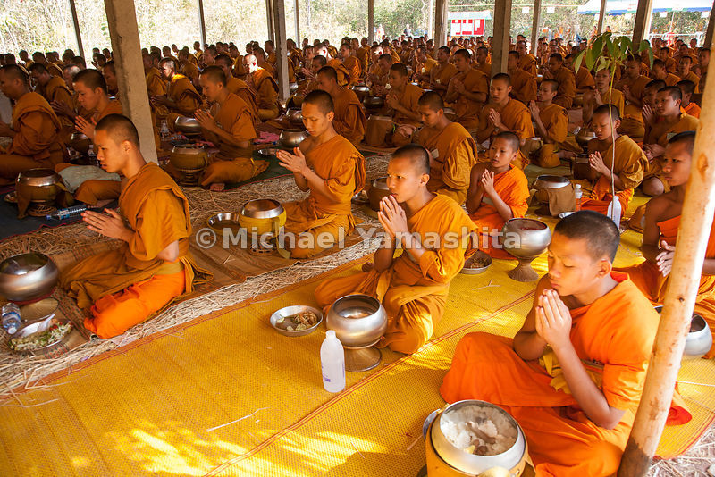 Winter camp for monks, 5km outside of the city. Pics of monks praying, walking meditation, breaking fast with rice porridge, binthabat, and eating scenes. 400 student monks from Nong Kai and Udon Thani provinces, Mahachulalongkorn University, come here each year for 10 days in January to further their religious study. Kok Non Pang forest.