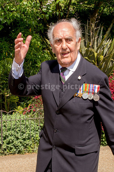 World War 2 Veteran Waving to the Crowds