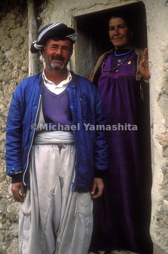 Two people pose for a picture outside their home in Sulaymaniah, Iraq.