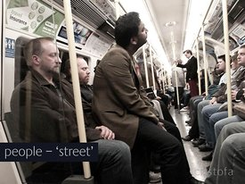 a man sits on London underground passengers' laps
