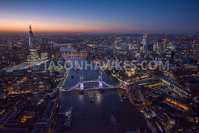 Night aerial view of Tower Bridge, River Thames, Shard and the City of London