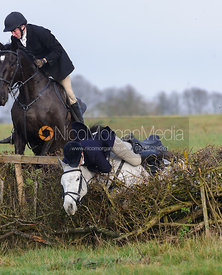 Jo Rutter jumping a hedge from Knossington Spinney