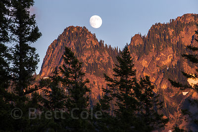 Full moon over mountains near Nahunta Falls, Mount Rainier National Park, Washington