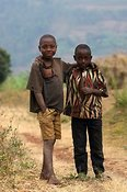 Friends in Rwanda on a dry dusty road