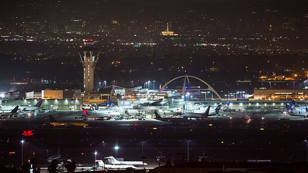 Close up Bird's Eye of Old & New Flight Control With Airplanes Lit at Night