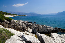 View of the mountains of mainland Greece from Limonari, Meganisi Island, Lefkas, Ionian Islands, Greece.