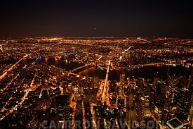Aerial photograph of New York City at night.