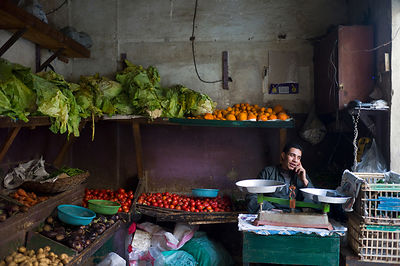 Egypt - Cairo - A man makes a telephone call in a vegetable shop, Bein al-Qasreen area