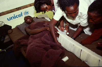 A man screams in pain as nurses splint his leg after an attack by the Interehamwe militia, Gisenyi, Rwanda