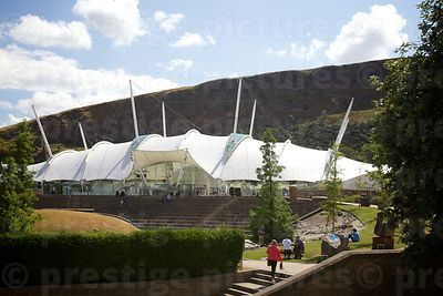 Tourist Attraction called OUR DYNAMIC EARTH with the hills of Holyrood Park in the Background