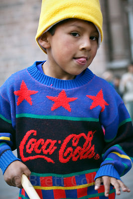 A boy poses for a photo in Cusco, Peru