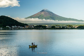 Mt. Fuji, the highest mountain in Japan at 3,776.24 m (12,389 ft) looking over Lake Kawaguchi, the second largest of the Fuji Five Lakes in terms of surface area.