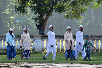 A Muslim family walks to the attend the Eid al-Adha, Red Road, Madian, Kolkata, India. I have the only photos taken by a foreigner of this most important day to Muslims at the most auspicious site in Kolkata for both 2012 and 2013.