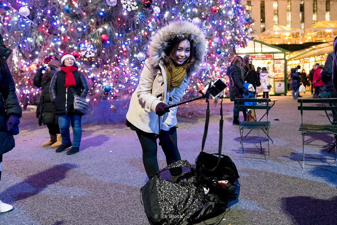A tourist taking a selfie at Bryant Park Winter village in Manhattan, New York City