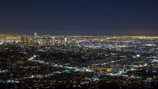 Bird's Eye: An Off Centered Medium Shot of Downtown Los Angeles Framed By Neighborhoods & Lights