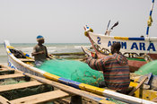 Fishermen fixing nets, Prampram, Ghana