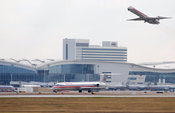 American Airlines jet on runway in front of the Dallas Ft. Worth Grand Hyatt